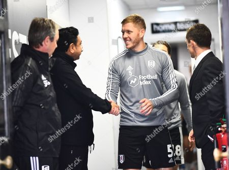 Fulham Chairman and owner Shahid Khan greets Alfie Mawson of Fulham