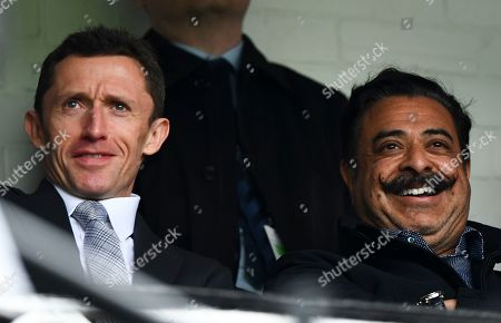 Fulham Chairman and owner Shahid Khan smiles next to CEO Alistair Mackintosh