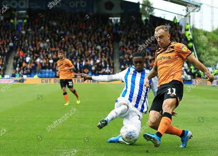 Kamil Grosicki of Hull City and Adama Diakhaby of Huddersfield Town