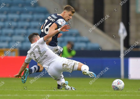 Jack Harrison of Leeds United is fouled by Jayson Molumby of Millwall who is shown a yellow card