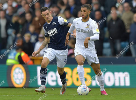 Tyler Roberts of Leeds United chased by Shaun Williams of Millwall