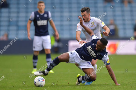 Mahlon Romeo of Millwall under pressure from Jack Harrison of Leeds United