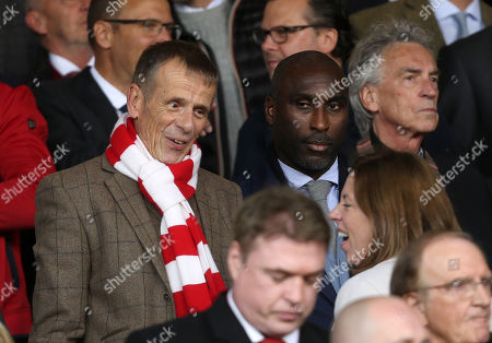 Actor Tom Watt and Sol Campbell in the stands