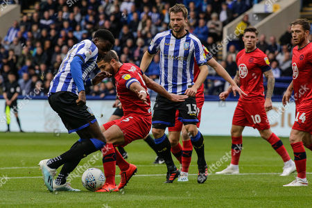 Stock Photo of 5th October 2019, Hillsborough, Sheffield, England; Sky Bet Championship, Sheffield Wednesday v Wigan Athletic : Sam Morsy of Wigan and Moses Odubajo (22) of Sheffield Wednesday tussle for the ball 