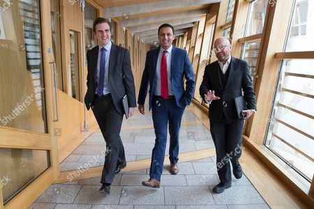 Scottish Parliament First Minister's Questions - Daniel Johnson, Anas Sarwar and Patrick Harvie, Co-convener of the Scottish Greens, make their way to the Debating Chamber.