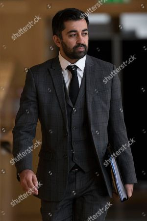 Scottish Parliament First Minister's Questions - Humza Yousaf, Cabinet Secretary for Justice, makes his way to the Debating Chamber.