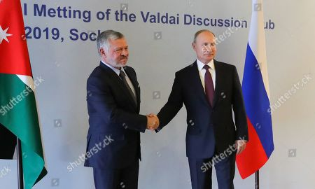 Russian President Vladimir Putin (R) and Jordan's King Abdullah II (L) shake hands  during their meeting on the sidelines of the Valdai International Discussion Club meeting titled ?The Dawn of the East and the World Political Order? in the Black sea resort of Sochi, Russia, 03 October 2019. The 16th annual meeting of the Valdai Discussion Club takes place from 30 September to 03 October.