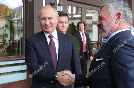 Russian President Vladimir Putin (L) and Jordan's King Abdullah II (R) shake hands  during their meeting on the sidelines of the Valdai International Discussion Club meeting titled ?The Dawn of the East and the World Political Order? in the Black sea resort of Sochi, Russia, 03 October 2019. The 16th annual meeting of the Valdai Discussion Club takes place from 30 September to 03 October.