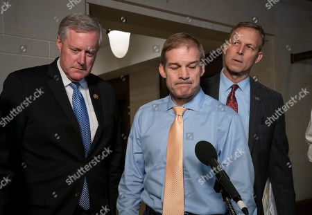 Mark Meadows, Jim Jordan, Scott Perry. Conservative Republican lawmakers, from left, Rep. Mark Meadows, R-N.C., Rep. Jim Jordan, R-Ohio, ranking member of the Committee on Oversight Reform, and Rep. Scott Perry, R-Pa., speak briefly to reporters before returning to a closed-door briefing with Kurt Volker, a former special envoy to Ukraine, as House Democrats proceed with the impeachment investigation of President Donald Trump, at the Capitol in Washington