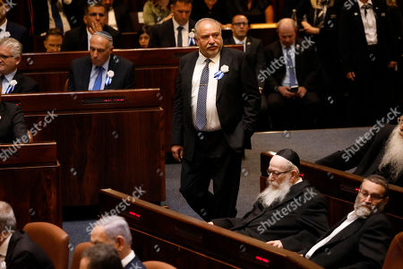 Avigdor Lieberman, leader of the Yisrael Beiteinu party (Israel Our Home) walks into the parliament in Jerusalem, ahead of swearing-in of the new Israel's parliament