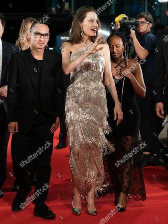 Maddox Jolie-Pitt, Angelina Jolie and Zahara Jolie-Pitt