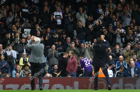 Fulham fans applaud Kit Symons and Chris Coleman as they collect their Forever Fulham awards at half time