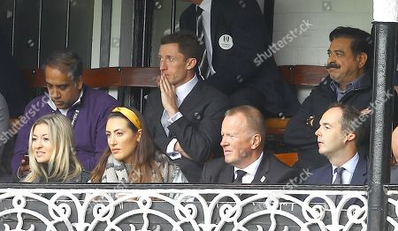 Fulham Chairman and owner Shahid Khan watches from the cottage