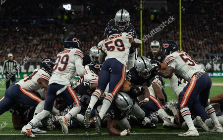 Oakland Raiders Running Back Josh Jacobs (28) jumps over Chicago Bears Linebacker Danny Trevathan (59) for a touchdown