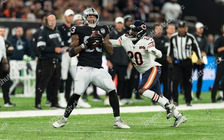 Oakland Raiders Tight End Darren Waller (83) is tackled by Chicago Bears Defensive Back Prince Amukamara (20)