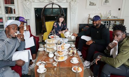 Stock Picture of Oakland Raiders  Defensive players Tahir Whitehead,Karl Joseph,Maurice Hurst and Johnathan Hankins  take afternoon  tea