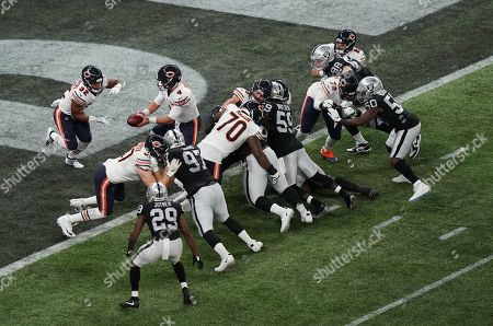 Chicago Bears quarterback Chase Daniel  (4) hands to Chicago Bears running back David Montgomery  (32)