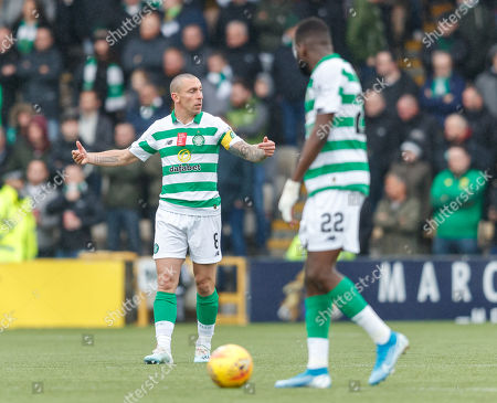 Celtic captain Scott Brown tries to compose the team after Scott Robinson of Livingston scored to give Livingston a 1-0 lead.