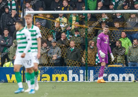 Celtic goalkeeper Fraser Forster looks out from his goal after Scott Robinson of Livingston scored to give Livingston a 1-0 lead.