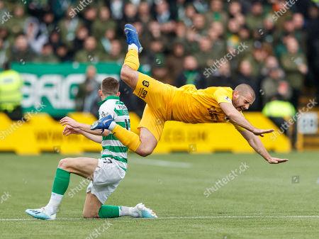 Ryan Christie of Celtic makes a late challenge on Scott Robinson of Livingston