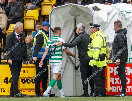 Ryan Christie of Celtic ant off by Referee Willie Collum for  a late challenge on Scott Robinson of Livingston