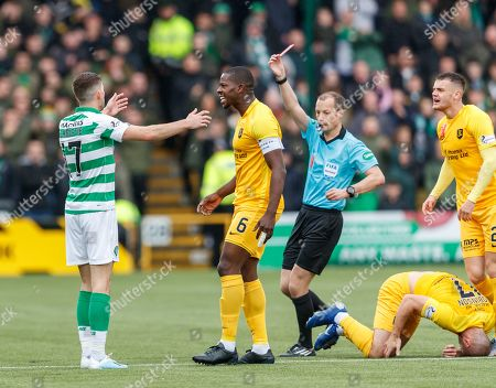 Stock Photo of Ryan Christie of Celtic ant off by Referee Willie Collum for  a late challenge on Scott Robinson of Livingston