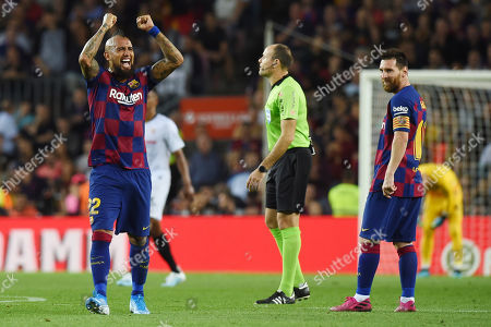 Lionel Messi of FC Barcelona looks his teammate Arturo Vidal after scoring the 2-0