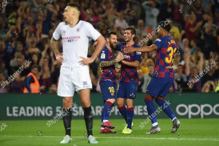 Lionel Messi of FC Barcelona clelebrates his goal (4-0) with his teammates Sergio Roberto and Ronald Araujo