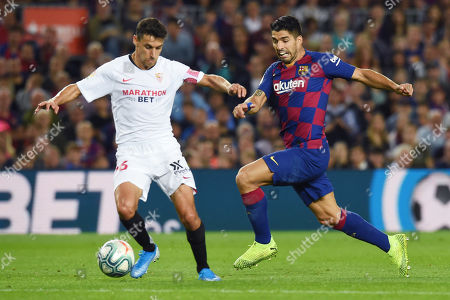 Luis Suarez of FC Barcelona and Jesus Navas of Sevilla FC