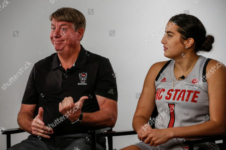 Stock Image of North Carolina State women's basketball coach Wes Moore, left, reacts to an answer by Aislinn Konig during the Atlantic Coast Conference women's NCAA college basketball media day in Charlotte, N.C