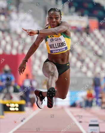 Kimberly Williams, of Jamaica, competes in the women's triple jump qualifications at the World Athletics Championships in Doha, Qatar