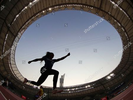 Caterine Ibarguen, of Colombia, competes in the women's triple jump qualifications at the World Athletics Championships in Doha, Qatar