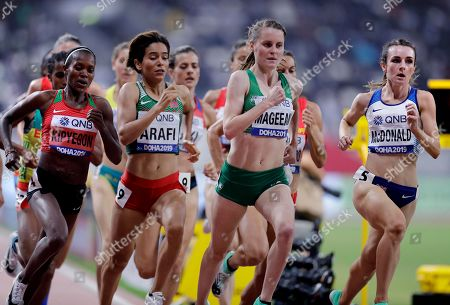 Stock Image of Faith Kipyegon of Kenya, Rababe Arafi, of Morocco, Ciara Mageean of Ireland and Sarah McDonald, of Great Britain, from left, compete in the women's 1500 meter semifinals at the World Athletics Championships in Doha, Qatar