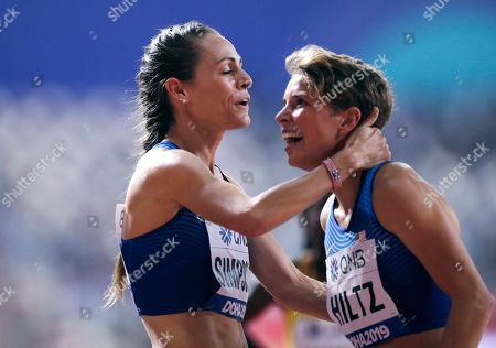 Jenny Simpson of the United States, left, embraces Nikki Hiltz, of the United States, after finishing a women's 1500 meter semifinals at the World Athletics Championships in Doha, Qatar