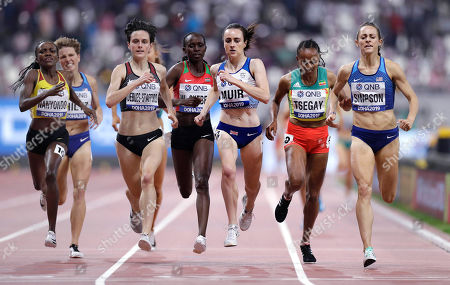 Winnie Nanyondo, of Uganda, Gabriela Debues-Stafford, of Canada, Laura Muir, of Great Britain, Gudaf Tsegay, of Ethiopia, and Jenny Simpson, of the United States, from left, race to the line in a women's 1500 meter semifinal at the World Athletics Championships in Doha, Qatar