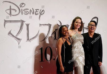 Stock Photo of Angelina Jolie (C) poses with her children Zahara Jolie-Pitt and Maddox Jolie-Pitt at the red carpet event of the movie 'Maleficent: Mistress of Evil' in Tokyo, Japan, 03 October 2019. The movie opens in Japanese cinemas on 18 October 2019.