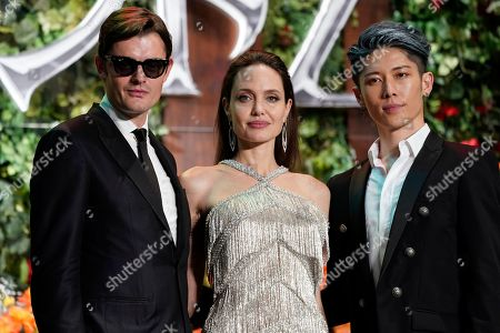 Angelina Jolie (C), British actor/cast member Sam Riley (L) and Japanese actor/cast member Miyavi pose during the red carpet event of the movie 'Maleficent: Mistress of Evil' in Tokyo, Japan, 03 October 2019. The movie opens in Japanese cinemas on 18 October 2019.
