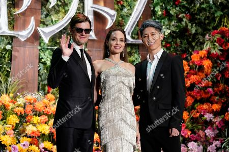 Stock Photo of Angelina Jolie (C), British actor/cast member Sam Riley (L) and Japanese actor/cast member Miyavi pose during the red carpet event of the movie 'Maleficent: Mistress of Evil' in Tokyo, Japan, 03 October 2019. The movie opens in Japanese cinemas on 18 October 2019.