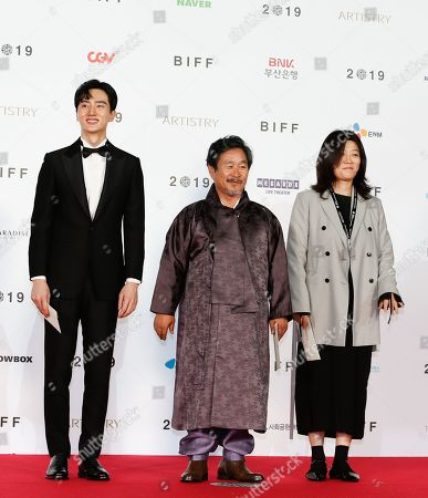 Stock Picture of South Korean actors Kim Jun Kyoung (L) Ki Joo-bong (C) and Lim Sun-aen (R) arrive for the opening ceremony of the 24th Busan International Film Festival (BIFF) plaza in Busan, South Korea, 03 October 2019. The BIFF will screen 303 films from 85 countries and will runs from 03 to 12 October 2019.