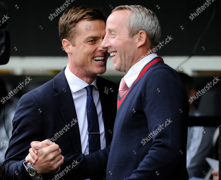 Scott Parker of Fulham and Lee Bowyer of Charlton Athletic in action during the Sky Bet Championship match between Fulham and Charlton Athletic at Craven Cottage in London, UK - 5th October 2019