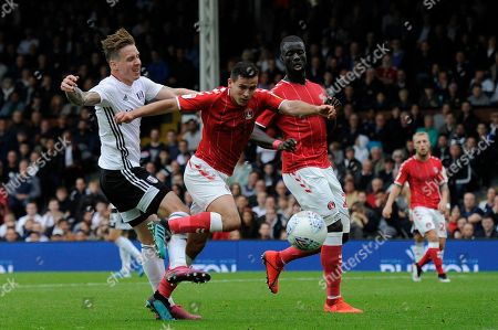 Stefan Johansen of Fulham and Josh Cullen of Charlton Athletic in action during the Sky Bet Championship match between Fulham and Charlton Athletic at Craven Cottage in London, UK - 5th October 2019