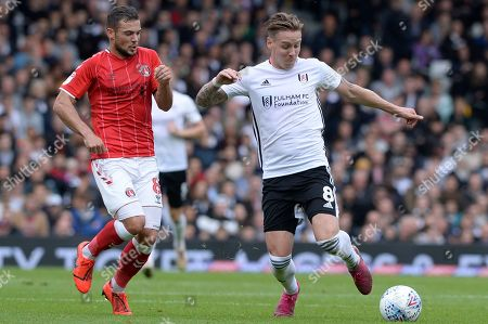 Stefan Johansen of Fulham and Jake Forster-Caskey of Charlton Athletic in action during the Sky Bet Championship match between Fulham and Charlton Athletic at Craven Cottage in London, UK - 5th October 2019