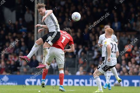 Stefan Johansen of Fulham and Conor Gallagher of Charlton Athletic in action during the Sky Bet Championship match between Fulham and Charlton Athletic at Craven Cottage in London, UK - 5th October 2019