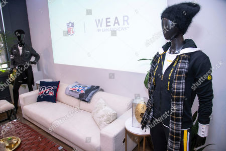 IMAGE DISTRIBUTED FOR NFL - A mannequin sports the WEAR full-zip logo drawstring hoodie, track pants, and long-sleeve T-shirt alongside new NFL 100 products celebrating 100 years of football, including a Northwest blanket and pillow, and Limited Edition Wilson Gold Football, during a preview event, in New York