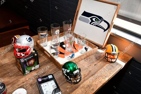 A collection of NFL Homegating items and games on display at a preview WEAR event, in New York. The items, from team pint glasses and wooden serving trays, to football helmets and more, are now available at NFLShop.com