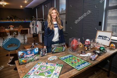 Erin Andrews poses with the latest and greatest NFL Homegating items and games, available at NFLShop.com, in New York