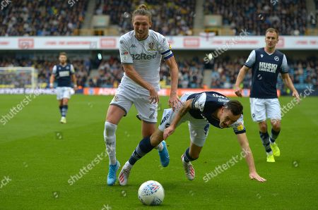 Shaun Williams of Millwall and Luke Ayling of Leeds United during the Millwall vs Leeds United EFL Championship Football match at the New Den
