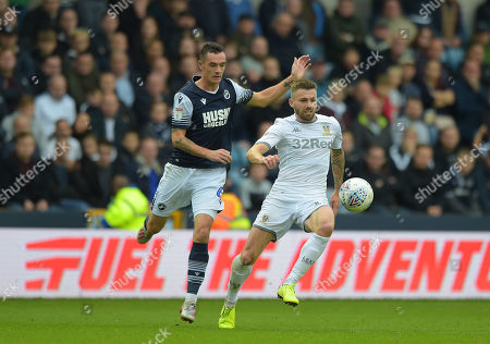 Shaun Williams of Millwall clashes with Stuart Dallas of Leeds United  during the Millwall vs Leeds United EFL Championship Football match at the New Den
