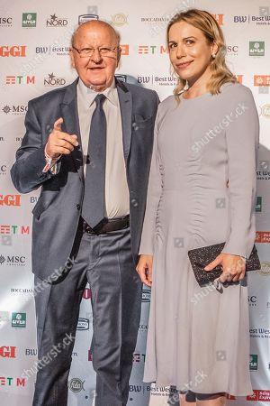 Stock Photo of Massimo Boldi and fiancee Irene Federica Fornaciari