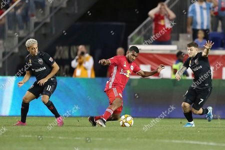 Stock Picture of New York Red Bulls midfielder Cristian Casseres Jr. (23) attacks the ball ahead of D.C. United midfielder Lucas Rodriguez (11) and D.C. United forward Paul Arriola (7) during an MLS soccer match, in Harrison, N.J. The final score was a 0-0 draw